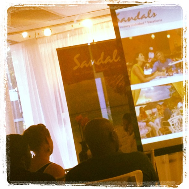 Attendees at Trilogy Event Design watching a presentation about Sandals Resorts