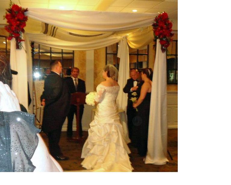 Mitzvah Consultant & Planner, Julie Herskovitz, standing under the Chuppah at her wedding.