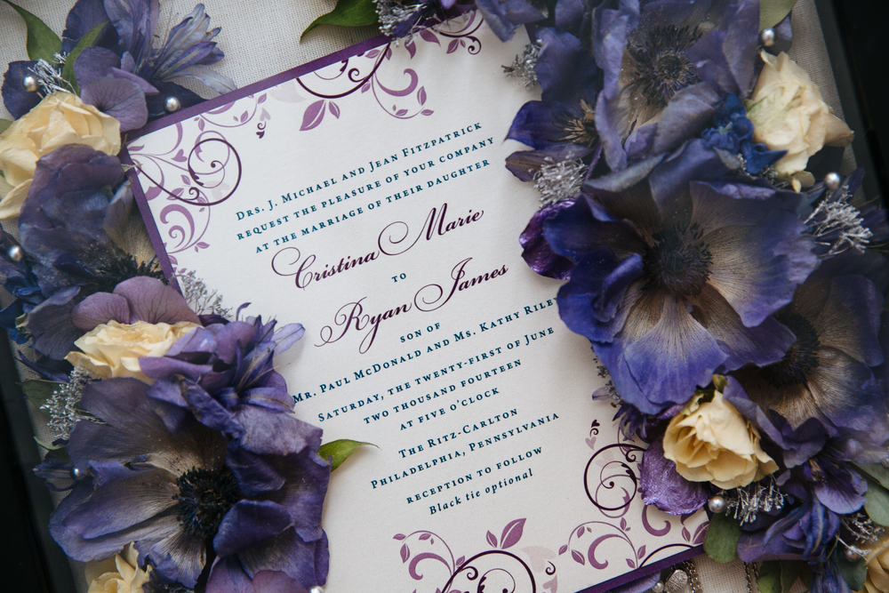 Midnight garden wedding invitation suite printed on metallic paper with purple backing. Photo by Jennifer Woodruff