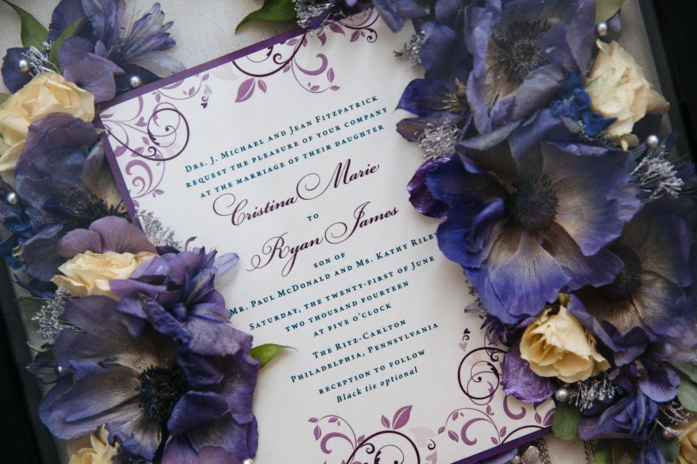 Midnight garden wedding invitation suite printed on metallic paper with purple backing. Photo by Jennifer Woodruff