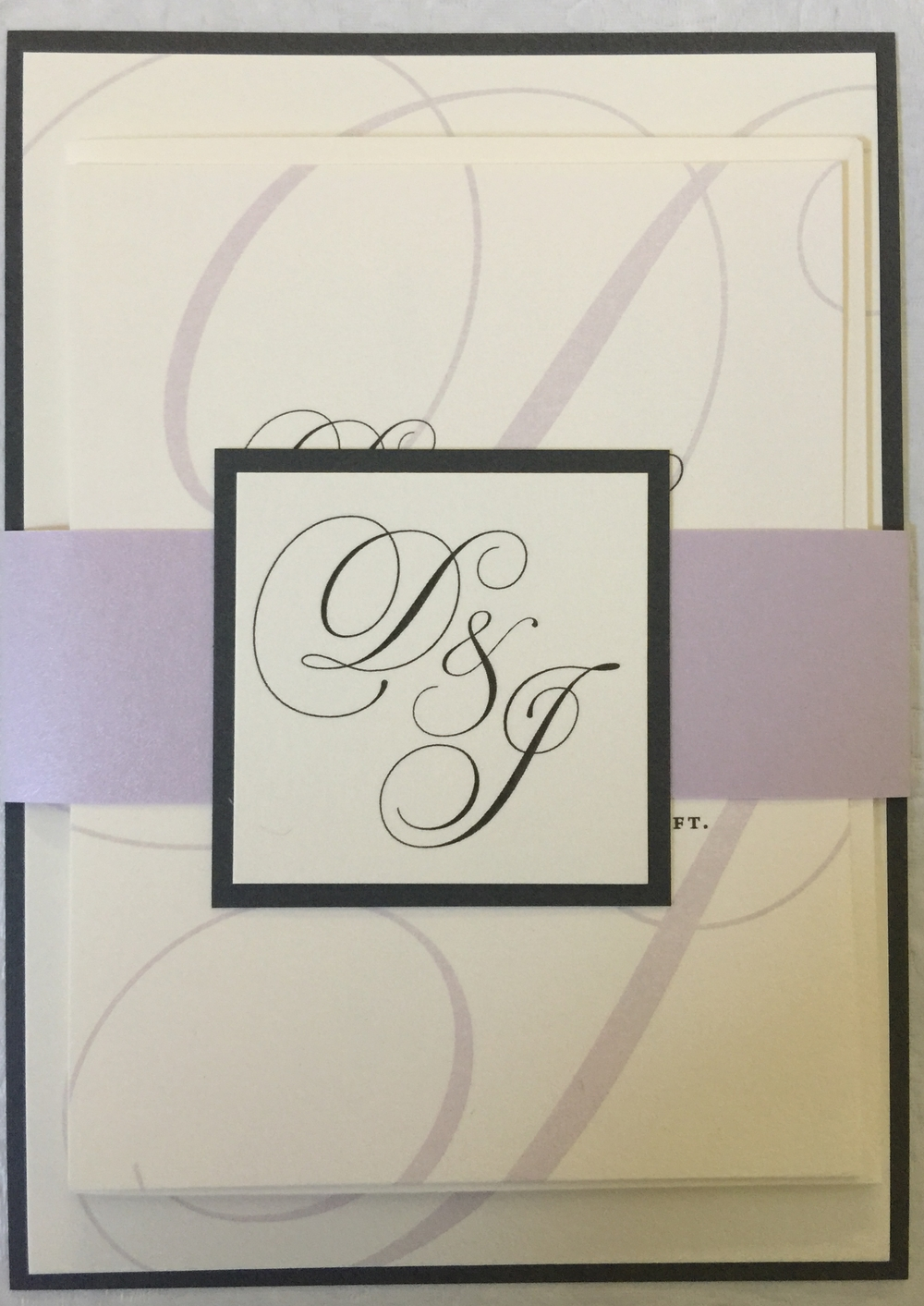 Custom-designed wedding invitation suite for Deborah and Jorge