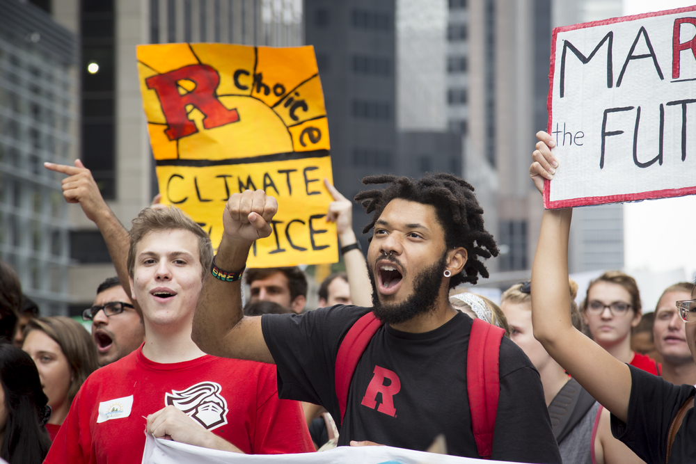 "Joshua Salley from environmental organization Save Our Shore chanted ""We dont want the dirty oil. Our life our future, our earth our future."" during the Climate Change march in New York City on the 21st of September, 2014. By Ann Wang"