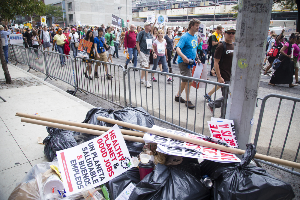 300,000  participants in the Climate Change march, attracted nation wide attention yet left behind litter in New York City on the 21st of September 2014. By Ann Wang