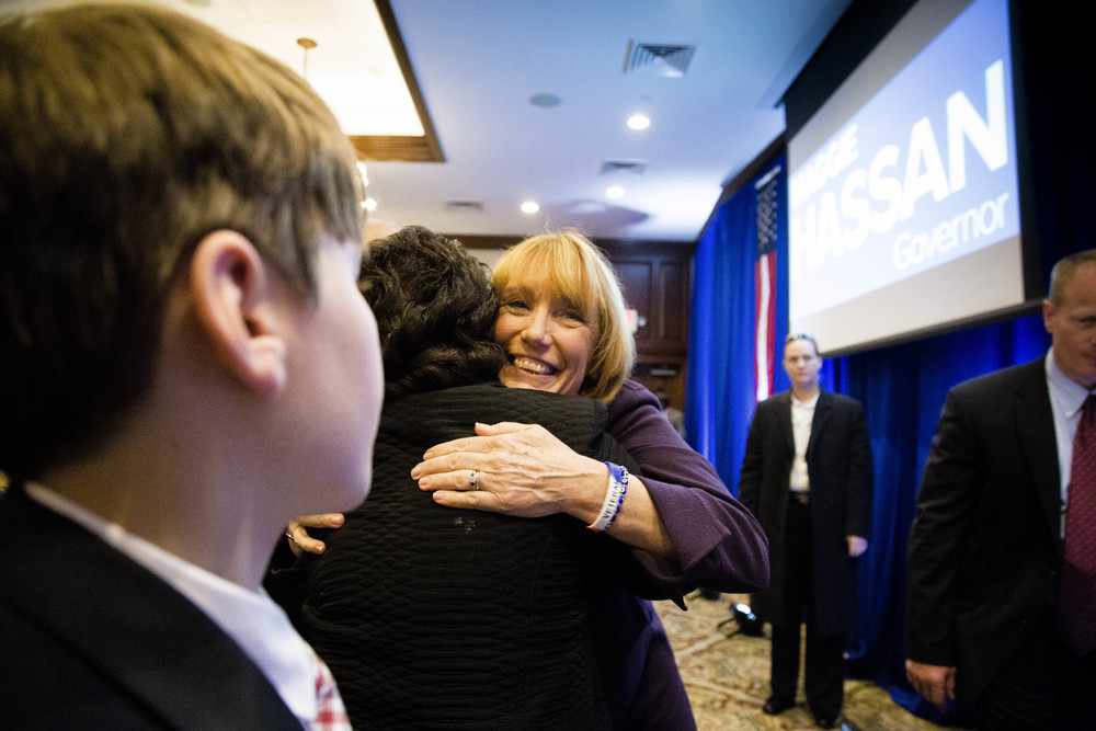 Manchester, NH, USA. Nov.4, 2014. Maggie Hassan wins New Hampshire Governor Race. A supporter give her a hug before she goes on stage and made a victory speech. Photo by Ann Wang