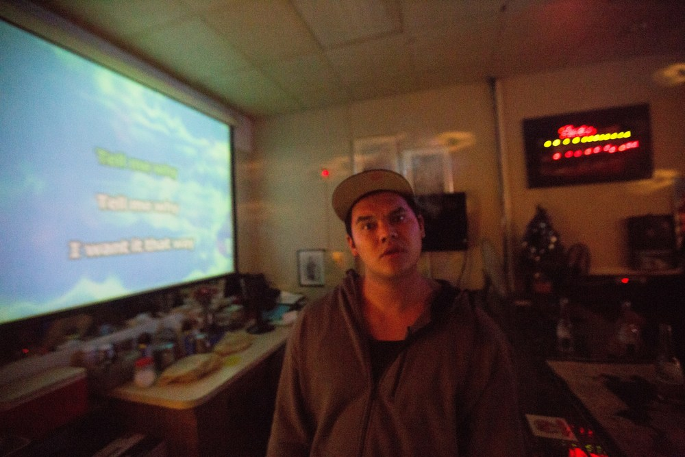 Former gang member Dao enjoys a night out at a youtube karaoke bar in Worceste. Photo by Ann Wang