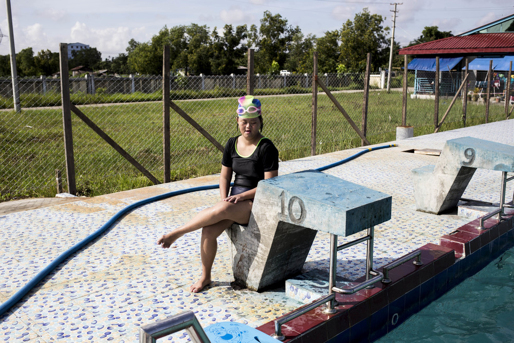 Theint Theint Thu taking a break from the swimming class. Coming to swimming class has give her a chance to get out of the house, she has since been a lot more happy and talkative according to her family members. Photo by Ann Wang