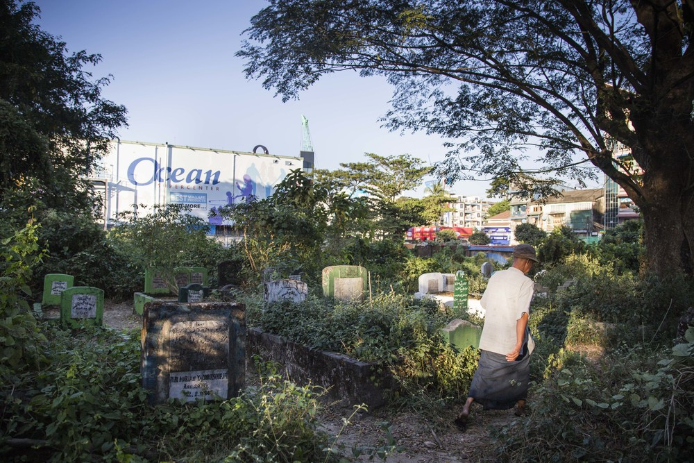 Muslim cemetery next to Ocean Super shopping center in Yangon, Myanmar. Photo by Ann Wang