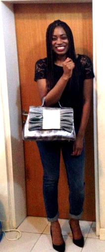 Simple Chic in her silvery grey Pleats Please Zashadu bag