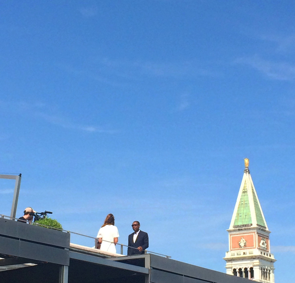 Okwi Enwezor being interviewed upon the roof top after the award ceremony. Nigerian/Ghanian artist, El Anatsui was awarded the Golden lion Lifetime award in front of my very eyes. What a moment!