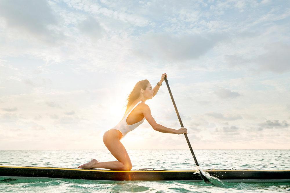 miami_lifestyle_beach_fitness_photography_david_gonzalez_girl_outdoor_workout_woman-paddling-fast-and-enjoying-the-sunrise.jpg