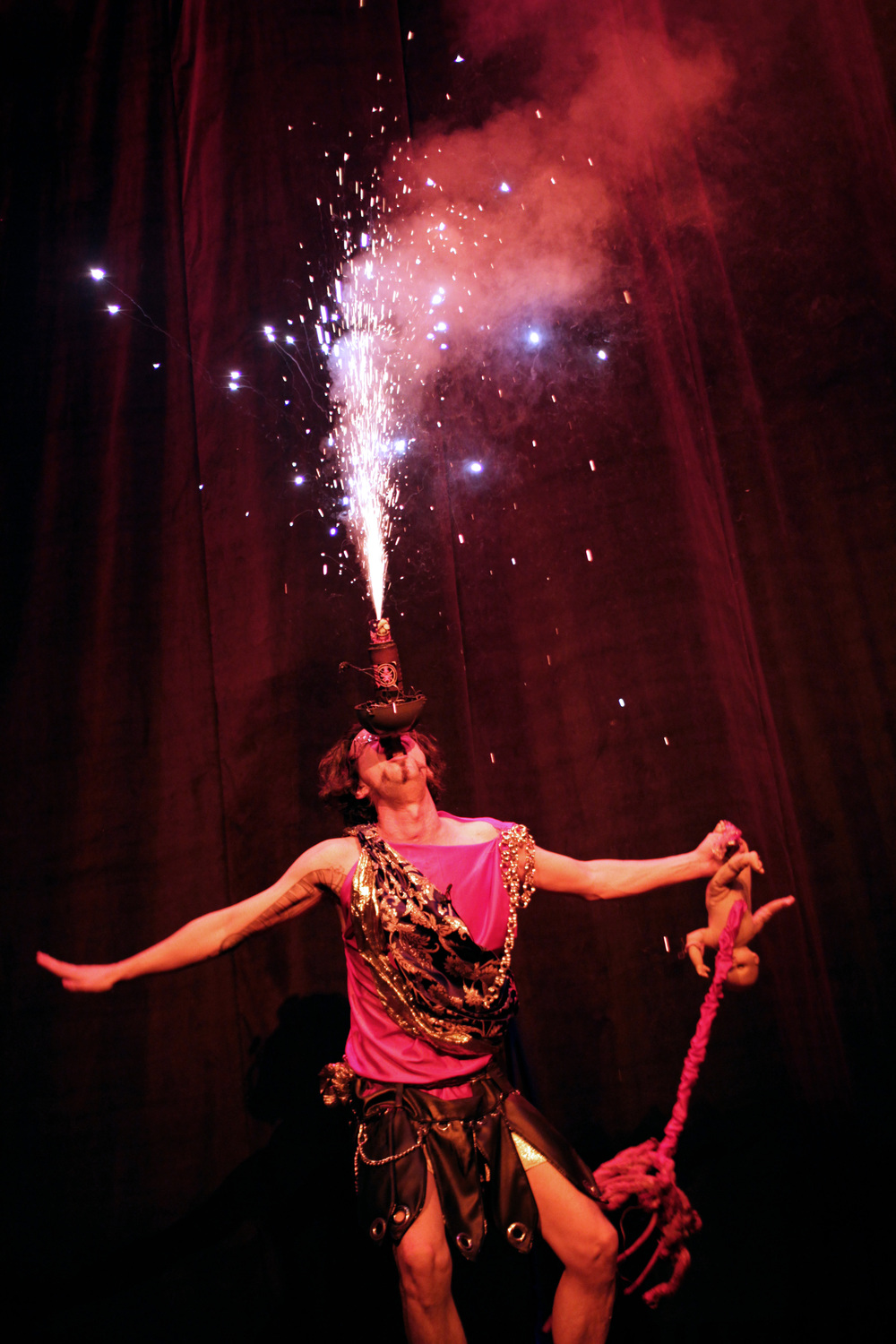 Caligula, swallowing a firework bedazzled sword, while carrying his newborn son/nephew. Very much in the spirit Christmas.