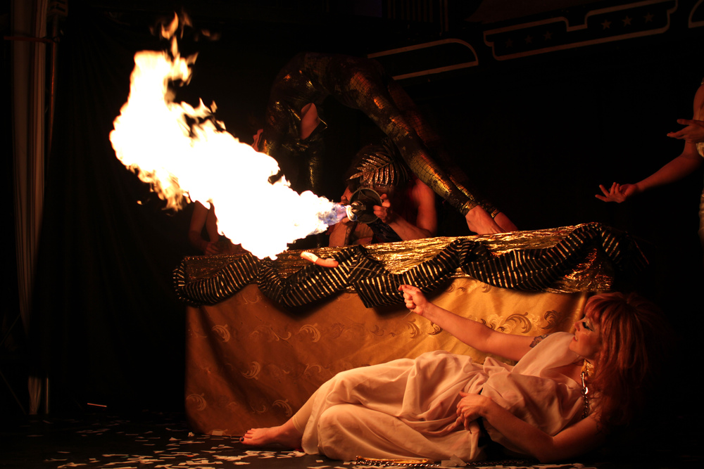 Caligula (Jelly Boy the Clown) roasts the serpent.