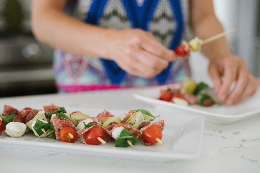 Anti-pasto skewers are so easy. Find what you like and add them on! In this skewer, Jacked Kitchen alternated cherry tomatoes, artichokes, salami, mozzarella, and basil. Drizzle with balsamic glaze to finish.
