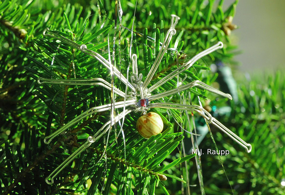 Spider ornaments evoke the legends of spiders, tinsel, and christmas trees.