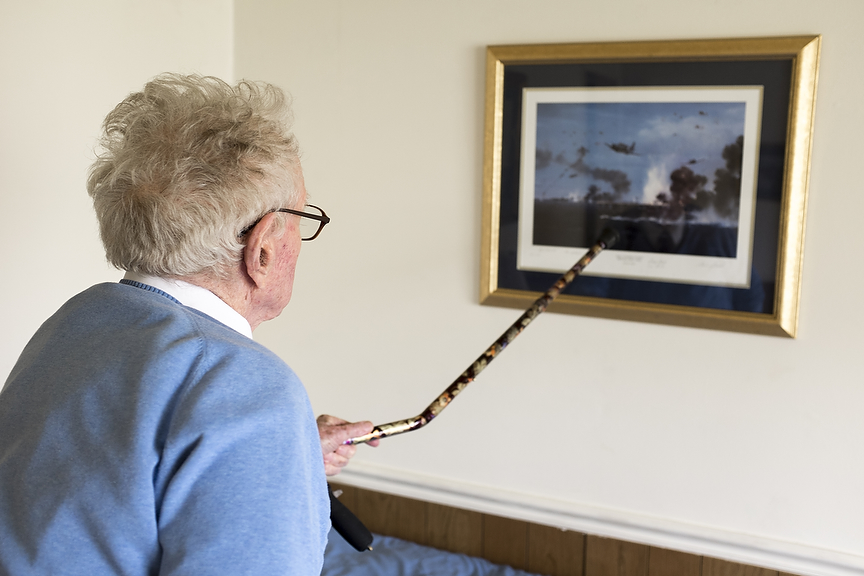 Crawford recalls the Battle of Midway after nearly 72 years as he looks at a painting of the battle in his home near Bethesda, Maryland. Crawford watched the battle unfold from the USS Yorktown before a series of bombing and torpedo attacks crippled the U.S. carrier and forced Crawford to abandon ship.