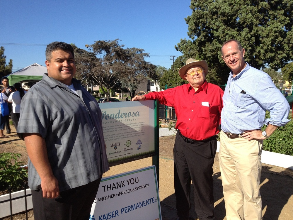Brian Chuchua pictured on right with Mayor Tom Tait.