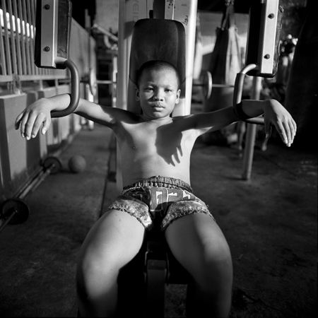 Young Boxer Preparing to Lift Weights