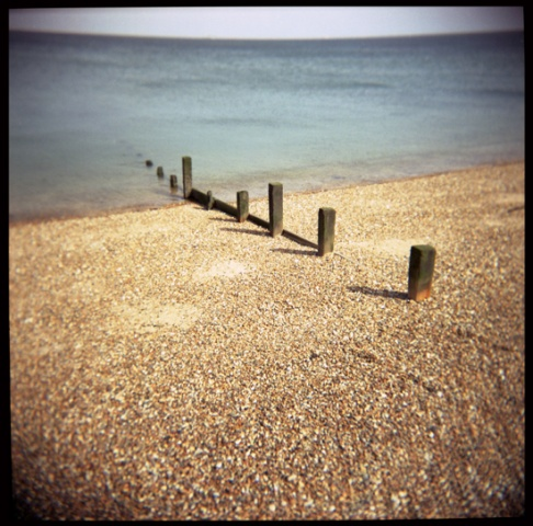 shingle, sea and a groyne, sheerness, kent, england