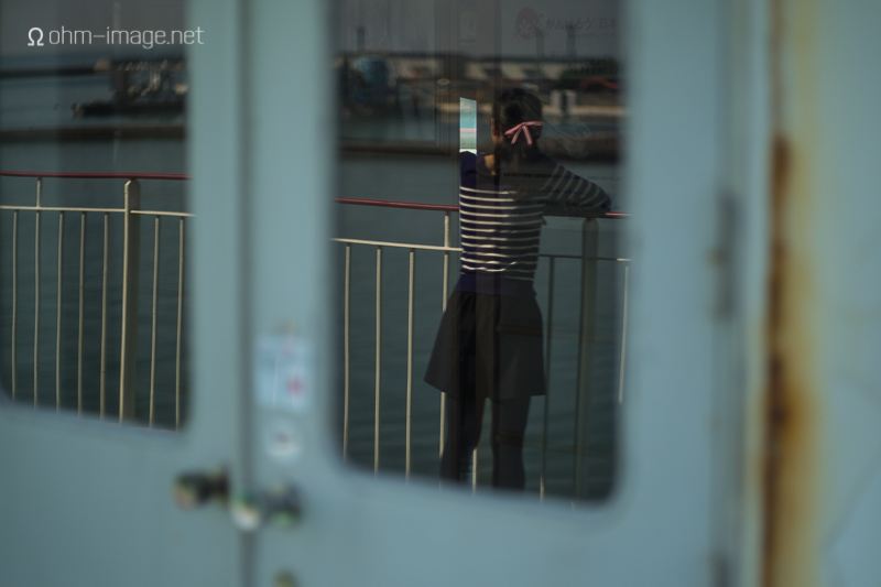 Megumi on board the ferry, looking out over Kansai