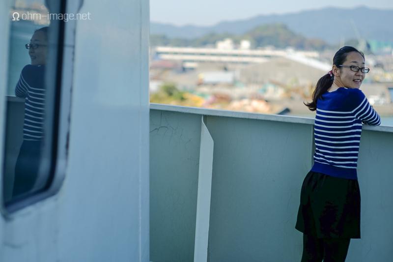 Megumi overlooking the docks in Fukuoka