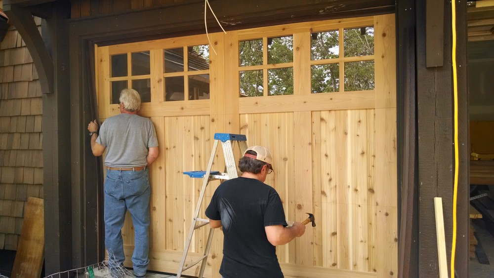 Mike and Greg of Horizon Carriage House Doors, installing the weather seal.