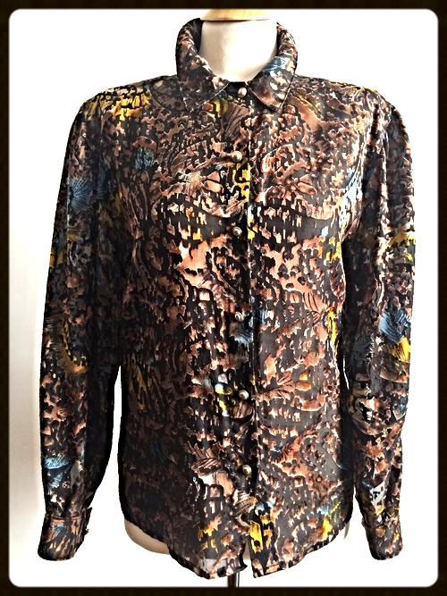 http://www.houseofterrance.com/clothing/vintage-italian-burn-out-blouse