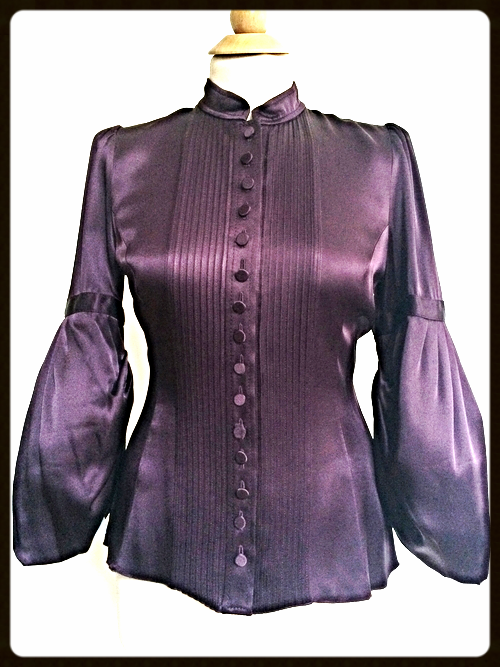 http://www.houseofterrance.com/clothing/andrew-ng-bell-sleeve-silk-blouse