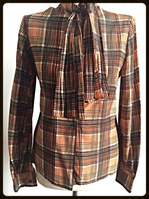 http://www.houseofterrance.com/clothing/vintage-adolfo-bow-blouse