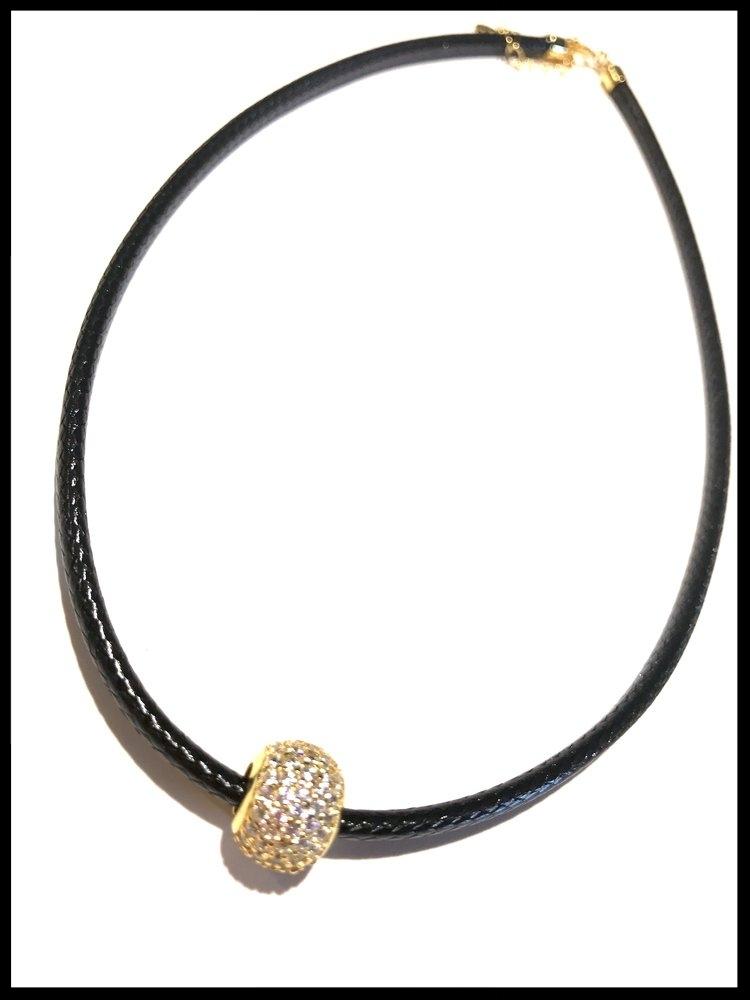 8. For the mom who must have the latest must-have  -- we're sure she knows chokers are the must-have necklace of the moment. This black leather choker with a tiny pavé rhinestone golden bead is just the thing!