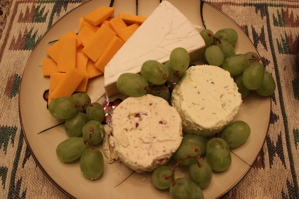 Blue cheese, sharp cheddar, grapes and some other kind of cheese