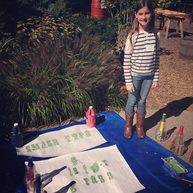 "What a great day of stamping green ABCs at the @greencitychallenge Eco Carnival!  Here's Vera with ""G is for Grass."""