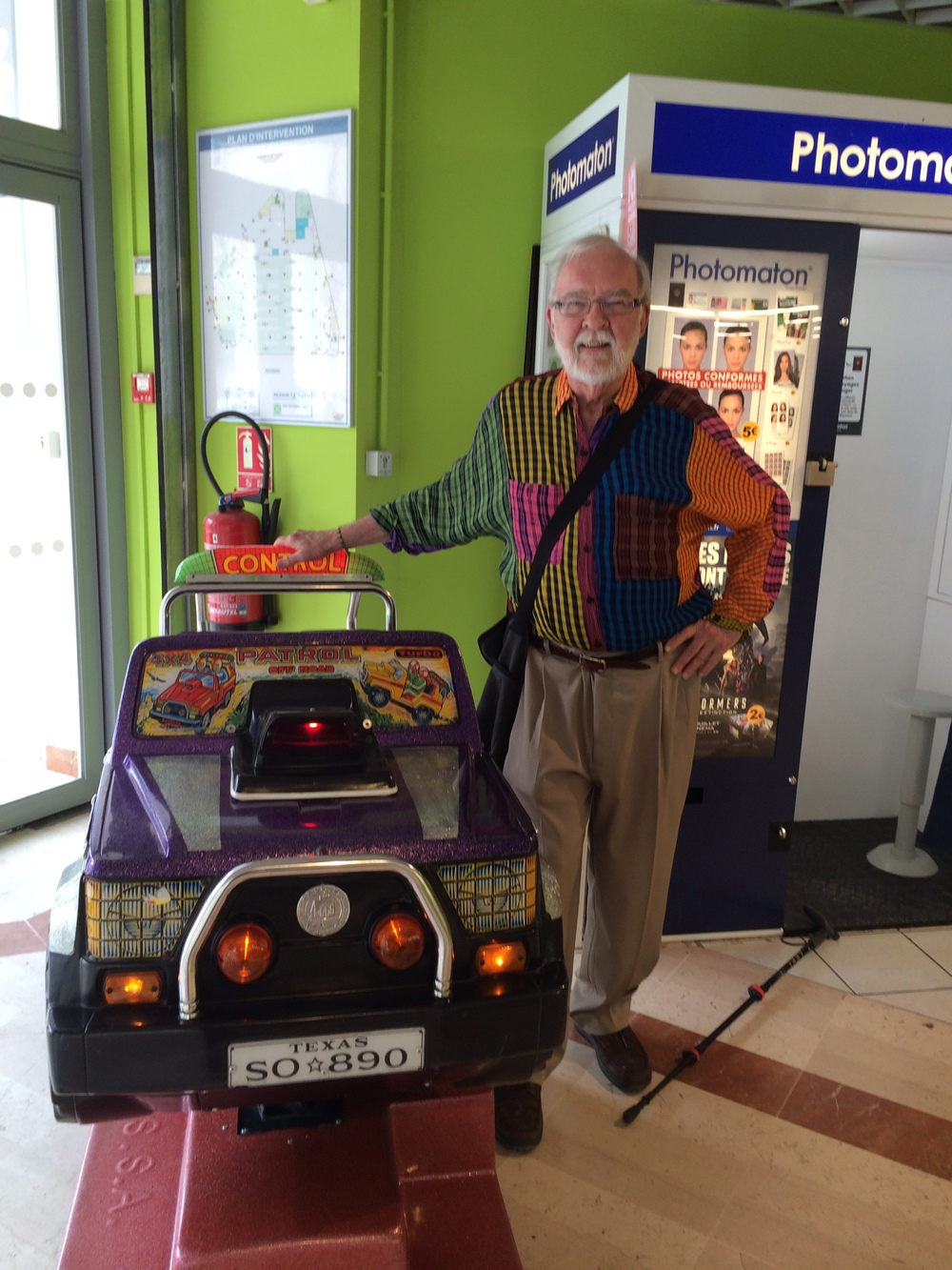 I couldn't resist posing, in France!, by this children's ride in a super market here. I was going to claim it was my method of transportation. Notice the Texas license plate.