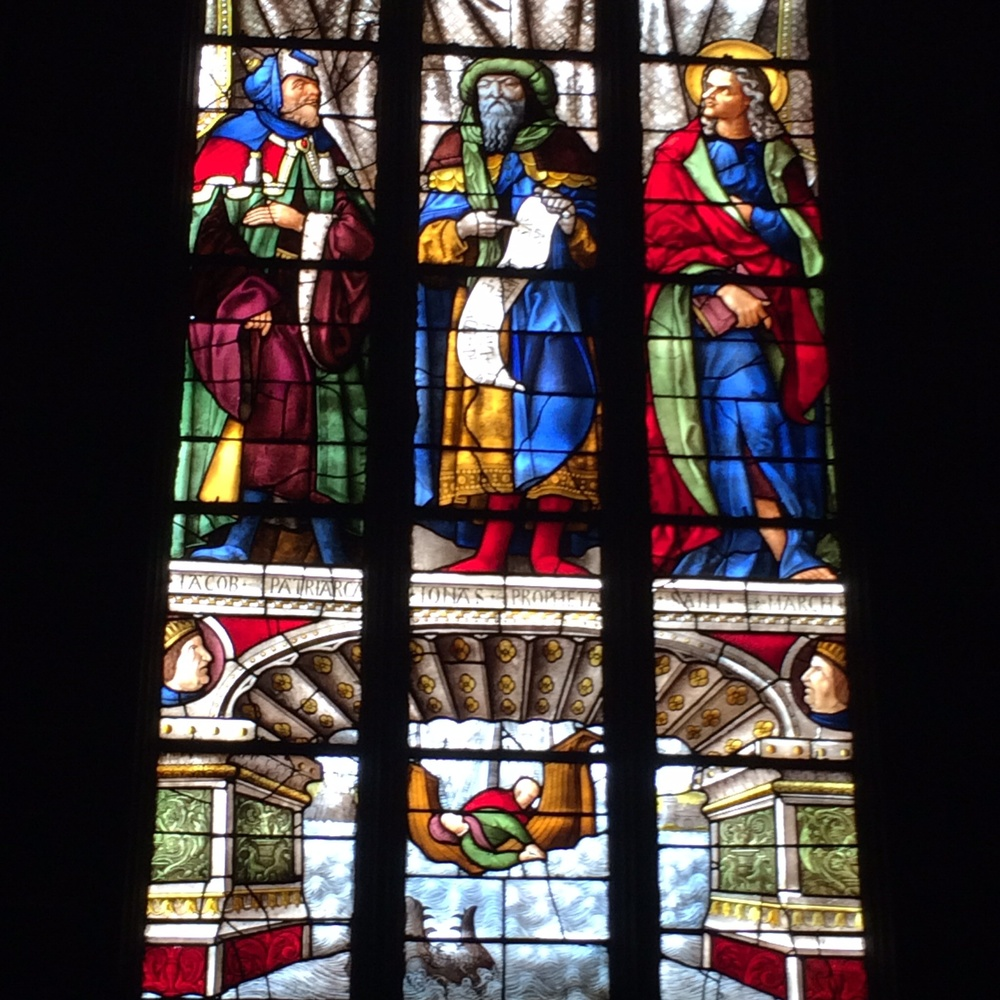 "Here is an example of the strained glass in the cathedral in Auch. The ""story"" in the bottom panel is that of Jonah and the whale."
