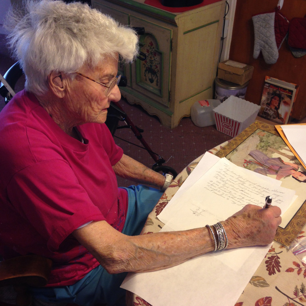 Grandma writing a note to my cousin, telling her the story of how she came into possession of the above china.