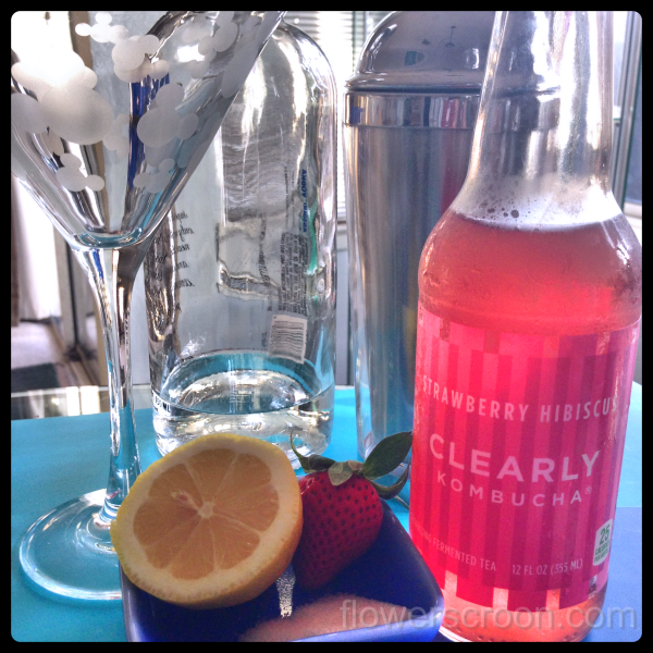 Strawberry Lemon Kiss Martini ingredients: Clearly Kombucha Strawberry Hibiscus, lemon, sugar, strawberry, vodka