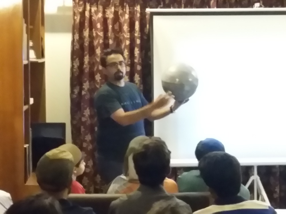 Using a Moon globe to show the location of the proposed settlement site
