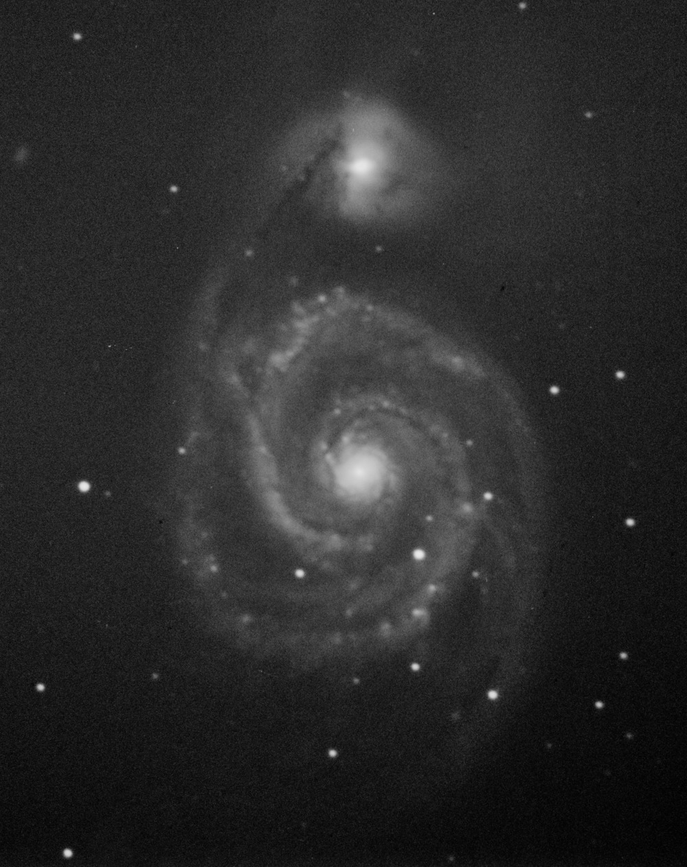 First light image from the new observatory. This image shows the galaxy pair M51 also known as the Whirlpool Galaxy, named after its conspicuous display of beautiful spiral arms. What is also evident is a smaller companion galaxy seen up top that is in a cosmic ballet with the bigger, more massive partner below.  Image credits: Sameer Rashid Shami Telescope and Camera: Celestron 8SE, SBIG STF8300 monochrome CCD Autoguider: SBIG STI monochrome CCD