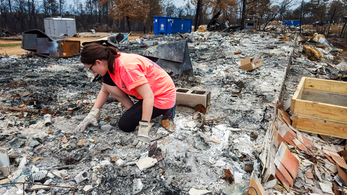 Claire sorting through the ashes in what used to be our bathroom