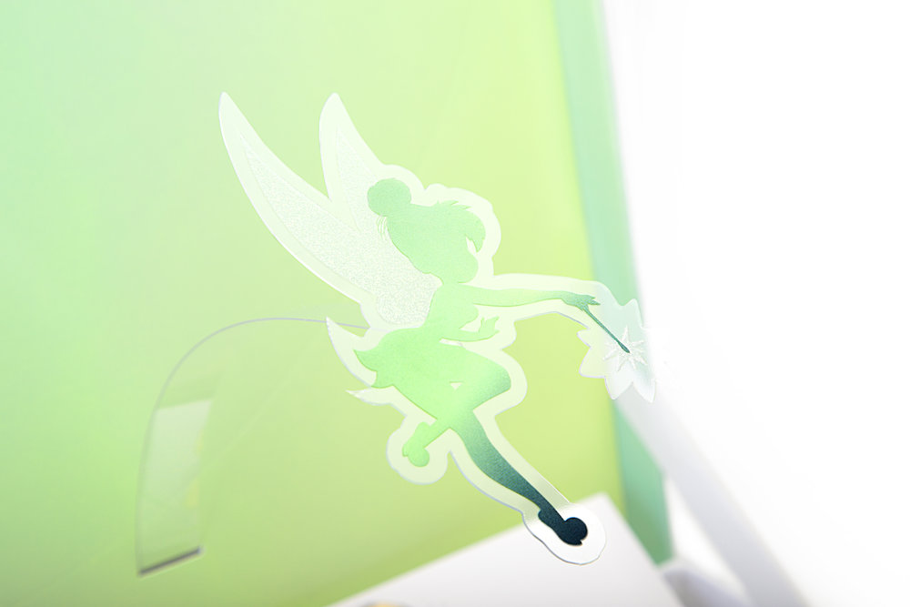 The package features a floating pop-up of Tinker Bell that hovers over the packaging when you open the box.