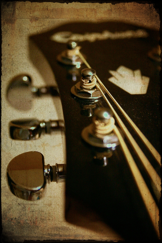 Thinking about how much I miss playing music everyday. I wish there were more hours in the day so I'd have time to sing and play.   [ Above : A photograph I took of my Epiphone Hummingbird, edited using Photoshop and a textured background from  NinianLif .]