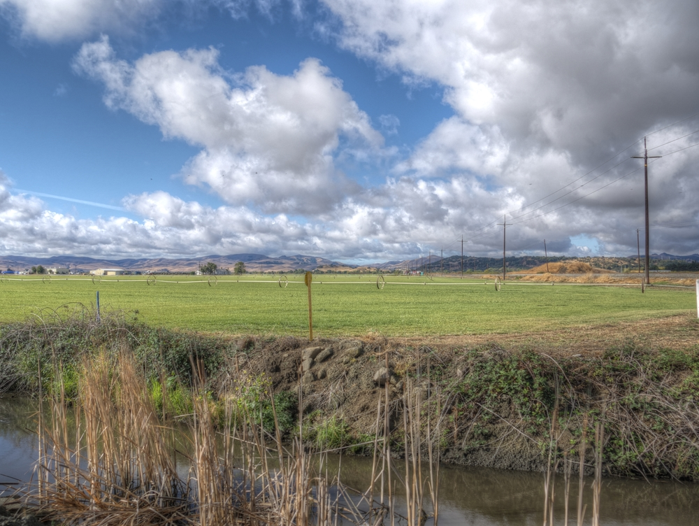 Clouds above farm and marshlands south of Fairfield, CA