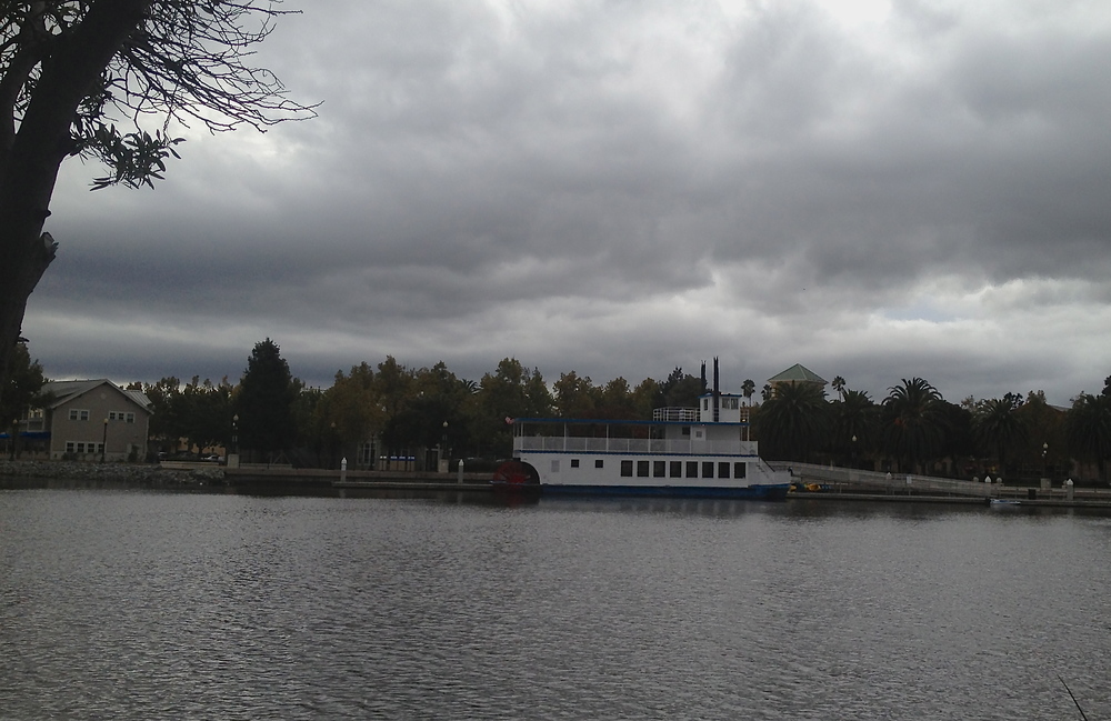 Riverboat Matthew McKinley docked under storm clouds - Suisun Waterfront