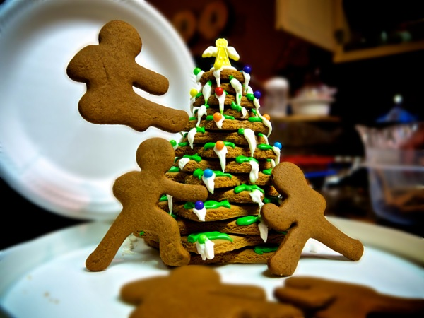 Ninja bread men fighting around the Christmas Tree.