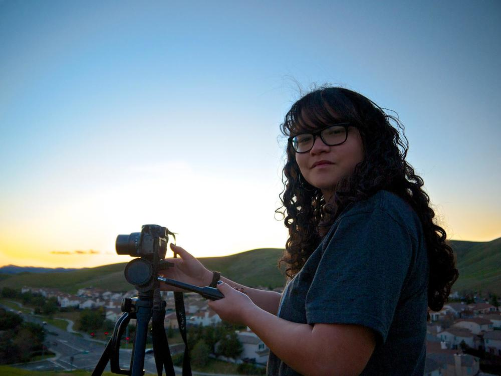 Jocelyn photographing a sunset.