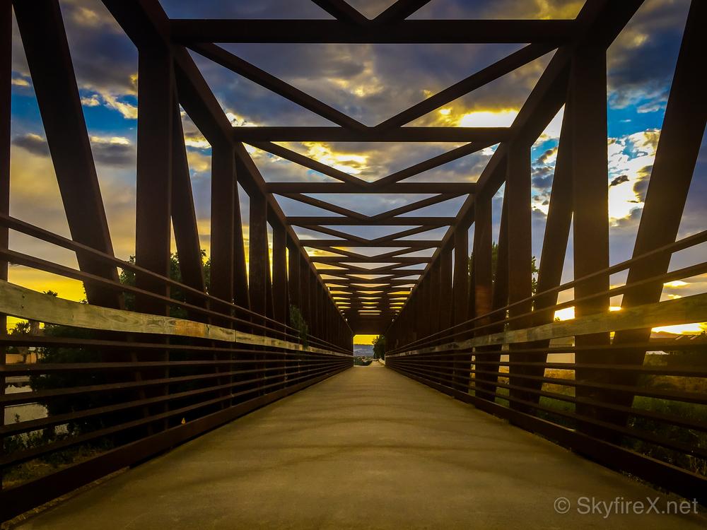 Sunset seen through the bridge's symmetry.