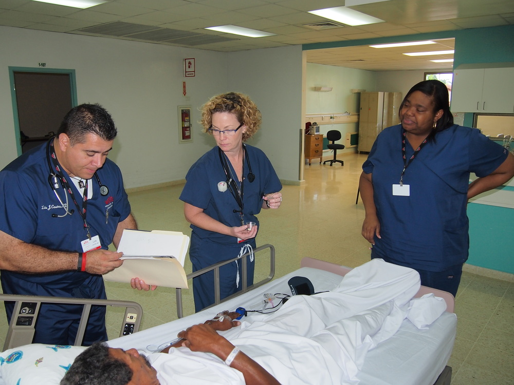 Above, Dr. Castro, Shelly, RN and Carla, RN, prepare a patient for surgery.  All three work at St. Joseph's Hospital Health Center in Syracuse, NY.