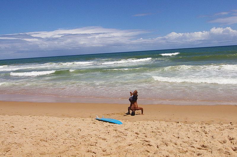 800px-A_surfer_stretching_on_a_beach_in_Bahia,_Brazil.jpg