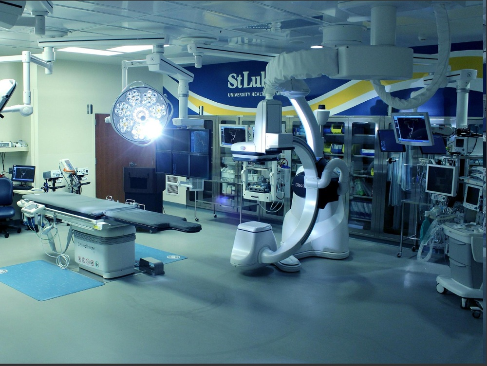 S kytron ceiling mounted Surgical Lights & Surgical Booms working in coordination with the GE Discovery IGS 730 robotic imaging system to create a Hybrid Operating Room