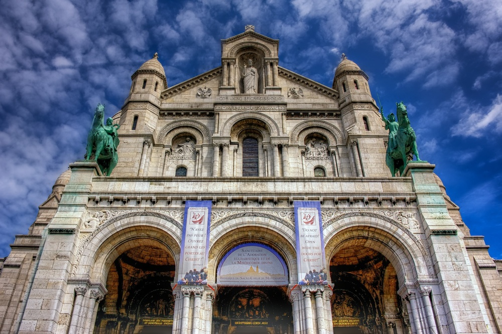 This one has been shared here before.  It's an HDR photo of the facade of Sacre Coeur.
