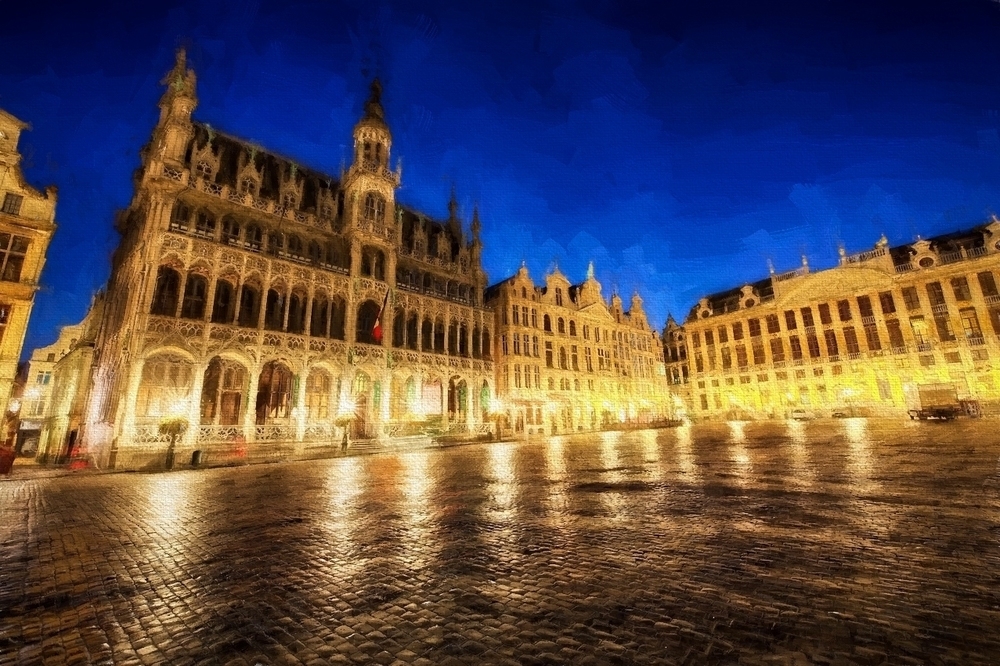 before sunrise in grand place, the beautiful town square in brussels, belgium